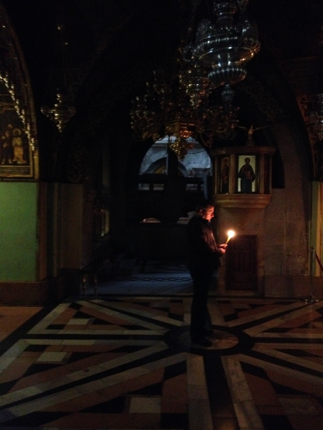 Man praying at the Armenian altar in the Church of the Holy Sepulcher.